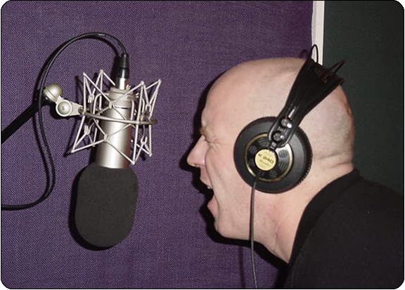 image of a man singing into a microphone